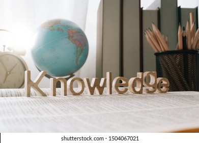 knowledge word on a book and school stationary background ,Education and knowledge concept