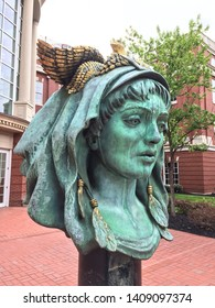 """Knoxville, Tennessee - April 17, 2015: The """"Beloved Woman of Justice"""" statue, created by Audrey Flack, is located outside the Howard H Baker, Jr United States Courthouse in downtown."""
