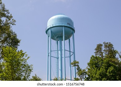 Knoxville, Tennessee - May 26, 2014: A Knoxville Utility Board water tower looms above nearby trees.