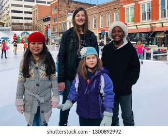 Knoxville, Tennessee / USA - Dec. 30, 2018: Group of multicultural children at outdoor seasonal ice skating rink Market Square downtown Knoxville