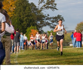 KNOXVILLE, TN - OCTOBER 28: The leader of the AAA boy's race at mile one of the TSSAA Region II Championship, on October 28, 2010 in Victor Ashe Park, Knoxville, Tennessee,