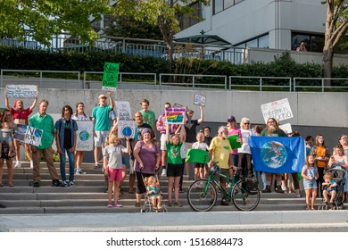 Knoxville, TN / USA - September 27, 2019: Climate Strike outside of the TVA Towers in downtown Knoxville with people holding various signs to save the planet.