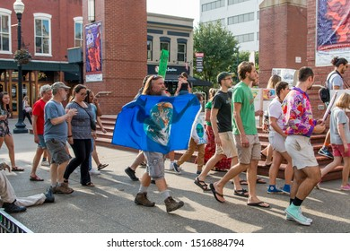 Knoxville, TN / USA - September 27, 2019: Climate Strike in downtown Knoxville Market Square and Krutch Park with people holding various signs to save the planet.