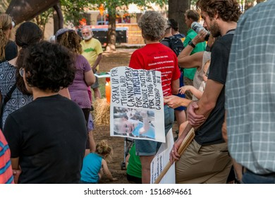 Knoxville, TN / USA - September 27, 2019: Climate Strike sign about saving the planet for the children with children in the picture in downtown Knoxville, Tennessee