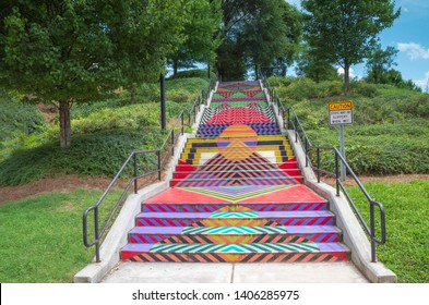 KNOXVILLE, TN/USA - AUGUST 8, 2018 - These painted stairs are one of the many murals used to tell the history of the city in a visual, artistic way and are located downtown near Worlds End Park.