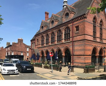 Knutsford Cheshire UK May 2020 Knutsford town centre with view of public house, pedestrians & cars