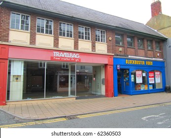 KNUTSFORD, ENGLAND - SEPTEMBER 18: Closing Down at Blockbuster Video and Travelbag September 18, 2010 in Knutsford, England. Photo illustrates recession hitting the UK economy, in this affluent area.