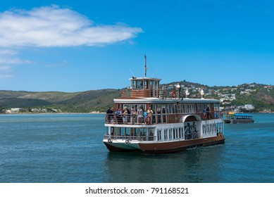 Knysna Lagoon, Mossel Bay, South Africa -- January 9, 2018 -- A tourist boat rides along the Knysna Lagoon in Mossel Bay, a famous tourist destination in South Africa. Editorial use only.