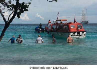 Ko Hong, Thailand - January 5, 2017:  People chilling in the water near tender boat