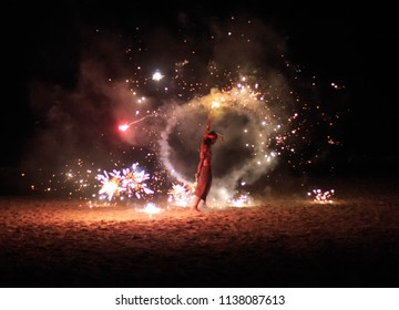 Ko Lanta, Thailand - March 12, 2016: Performer lights off fireworks on dark beach