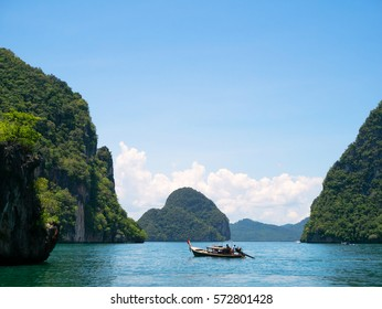 KO LAO LADING ISLAND, KRABI, THAILAND - CIRCA MAY 2015: Group of cliff tropical islands and traditional longtail boat in Thailand near Krabi