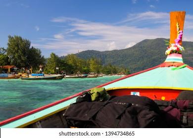 KO LIPE (ANDAMAN SEA), THAILAND - DECEMBER 18. 2013 - Arriving with long-tail boat and backpacks at Ko Lipe