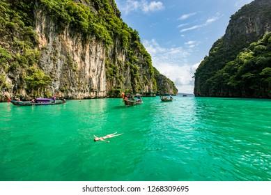 Ko Phi Phi Lee Islands, Krabi / Thailandia - 24/08/2018: View of Pileh Lagoon Long Tail and Beautiful Woman Swimming