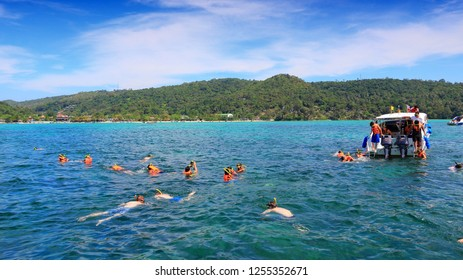 KO PHI PHI, THAILAND - DECEMBER 20, 2013: Tourists snorkel in open sea offshore near Ko Phi Phi island in Thailand. 26.7 million people visited Thailand in 2013.
