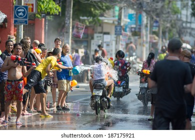 KO SAMUI, THAILAND - APRIL 13: Foreigners and Thai people enjoy splashing water together in songkran festival on April 13, 2014 in Ko Samui island, Thailand.