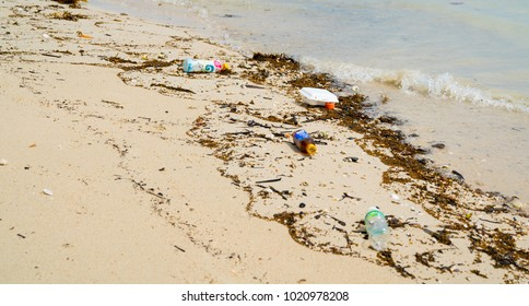 KO SAMUI, THAILAND - JANUARY, 25; environmental degrading waste and rubbish carelessly discarded on tropical island beach January 25, 2017 Ko Samui Thailand