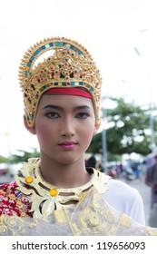 "KO SAMUI, THAILAND - NOVEMBER 7: Unidentified kid participates in ""Ngan Chak Pra"", a traditional buddhist festival on November 7, 2012 in Koh samui,Suratthani, Thailand."