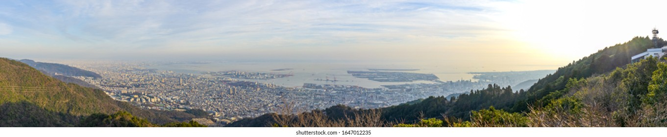 Kobe city panoramic view from Mt. Maya Kikusedai park observatory platform in sunny day sunset time with blue sky background, famous by the 10 ten million dollar night views. Hyogo Prefecture, Japan