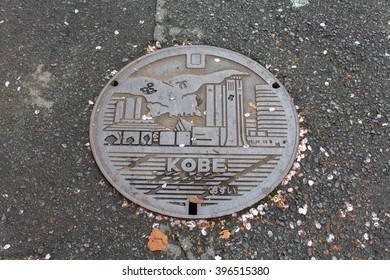 KOBE, JAPAN - APRIL 11, 2015:Drain cap art on the surface of sewer cover on the walk way kobe japan