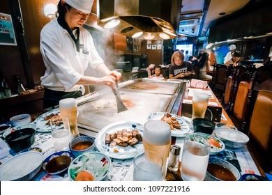 KOBE, JAPAN - AUGUST 21, 2017: Unidentified chef cook beef steak for the customer at Steak Land steak shop in Kobe, Japan. Beef steak is famous food of Kobe city.