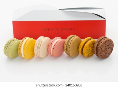 "KOBE, JAPAN - DECEMBER 27, 2014: Macaroons from a Pierre Herme Paris branded pastry boutique. French Vogue magazine dubbed renowned French pastry chef Pierre Herme as ""The Picasso of Pastry."""