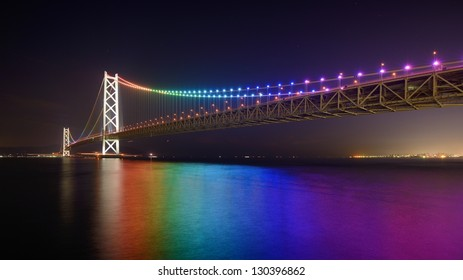 KOBE, JAPAN - JANUARY 31: Rainbow lights on Akashi Kaikyo Ohashi January 31, 2013 in Kobe, JP. Also known as Pearl Bridge, it has the world's longest central span at 1,991 meters.