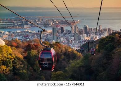 Kobe, Japan - November 25, 2016: Shin-Kobe Ropeway cable cars to Nunobiki Herb Garden with autumn foliage color and skyline city view at sunset.