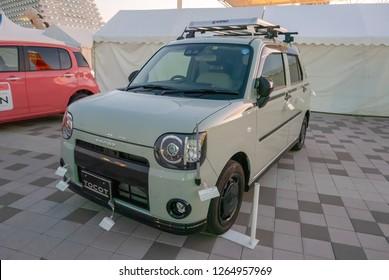 KOBE, JAPAN-NOVEMBER 10, 2018: Daihatsu Mira Tocot car in Kobe, Japan. This is a Kei car where it must meet certain Japanese regulation in order to qualify under Kei car category.