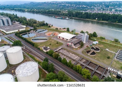 Koblenz GERMANY 21.07.2018 Aerial view of modern industrial sewage treatment plant beside the rhine river