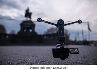 Koblenz, Germany - December 21st, 2018; A camera hanging at the WIRAL LITE while making a timelapse. Wiral Lite is a cablecam wich was founded on Kickstarter  in only 90 seconds.
