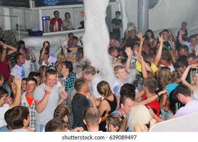 Koblevo, Ukraine July 14, 2011: crowd of people are full of happiness at foamy party in night club. Foam party in nightclub.