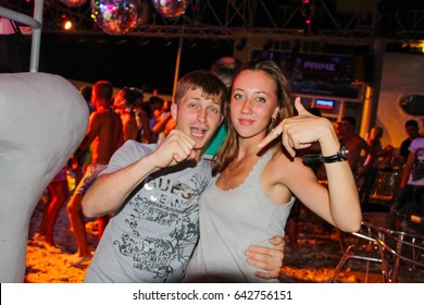 Koblevo, Ukraine July 14, 2011: Aqua night club. People  smiling and posing on cam during concert in night club party. Man and woman have fun at club. Boy and girl at night club party