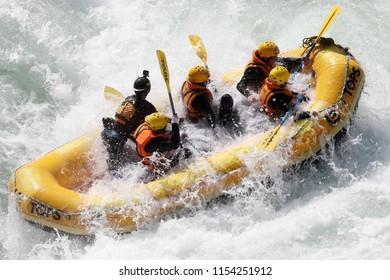 KOBOKE, TOKUSIMA, JAPAN - AUGUST 6, 2018: White water kayaking on the rapids of river Yosino on August 6, 2018 in Koboke Canyon, Japan. Yosino River is one of the most popular among rafters in Japan.