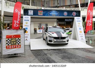 KOCAELI, TURKEY - NOVEMBER 17, 2018: Bugra Can Kilic with Fiat Egea 1.4 T-Jet of Fiat Motorsporlari Team in ceremonial start of Kocaeli Rally