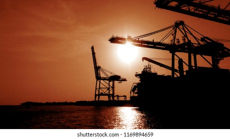 Kochi docks and shipping container port in a evening