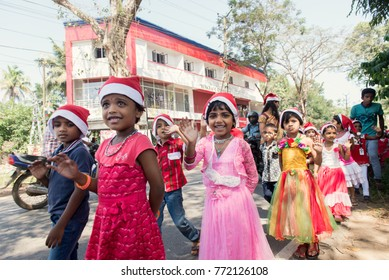 Kochi, India - December 23, 2015: Pupils celebrating Christmas in the St. Ann's public school (Kerala, India). Children wish Merry Christmas to local citizens