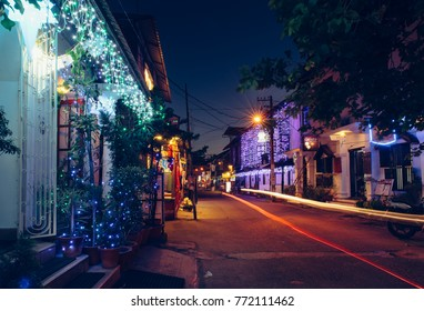 Kochi, India - December 31, 2015: Illuminated streets of Fort Kochi (Kerala) at night during New Year holidays. Interior of shops and hotels. Empty street