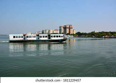 Kochi, India - February 13, 2020 - The view of the Marine Drive in Ernakulam and a passenger ferry in Fort Kochi (Fort Cochin)