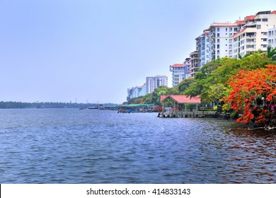 KOCHI, KERALA, INDIA, APRIL 30, 2016: Buildings and beautiful trees. View of the Marine Drive at Kochi from the wharf,