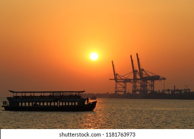 Kochi, Kerala, India - February 3, 2018: Sunset view of ferry off Marine Drive Ernakulam