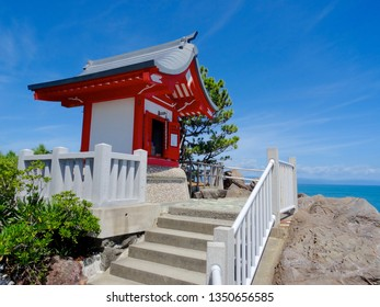 Kochi, Shikoku, Japan - 18th August 2018 : Close up of the little shrine located on a cliff at the Katsurahama beach in Kochi, Japan