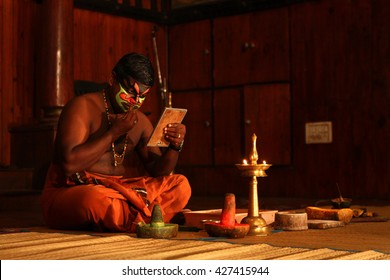 KOCHI,INDIA-MAY 13: Kathakali dancer put makeup before the dance performance at Kochi,India on May 13,2016. Kathakali is a folk dance form of Southern India where dancers prepare their own makeup