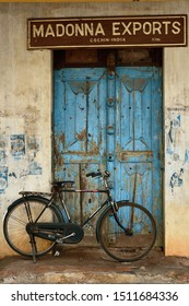 KOCHIN, KERALA,  INDIA - 29 NOVEMBER 2018: The bicycle before the old entry to the company engaging in the spice trade exotic, Cochin, India.