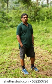 KODAIKANAL, INDIA - JUNE 29TH, 2015: Serious man sad face on nature background