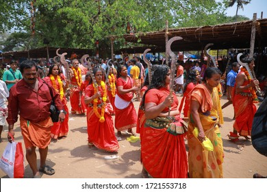 KODUNGALLUR, INDIA - APRIL 08 :  Unidentified oracles and devotees sing and dance as a ritual in the Bharani festival at Kodungallur Bhagavathi temple on April 08, 2019 in Kodungallur,Kerala, India.