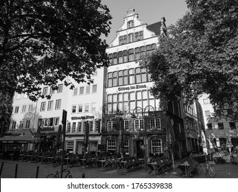KOELN, GERMANY - CIRCA AUGUST 2019: Alter Markt (translation old market) historic square in the Altstadt (translation old town) in black and white