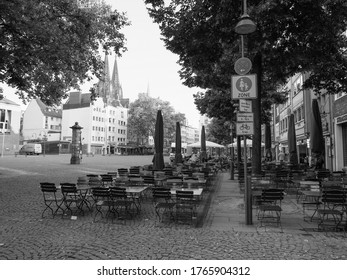 KOELN, GERMANY - CIRCA AUGUST 2019: Alter Markt (translation: old market) historic square in the Altstadt (translation: old town) in black and white