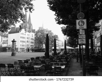 KOELN, GERMANY - CIRCA AUGUST 2019: Alter Markt (translation old market) historic square in the Altstadt (translation old town), black and white