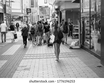 KOELN, GERMANY - CIRCA AUGUST 2019: People in Hohe Strasse (meaning High Street) shopping street in black and white