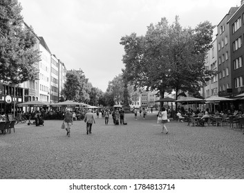 KOELN, GERMANY - CIRCA AUGUST 2019: Alter Markt (old market) historic square in the Altstadt (old town) in black and white